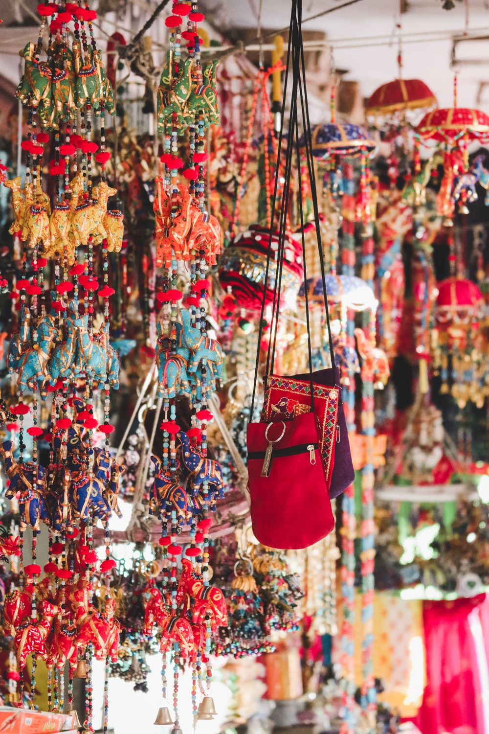 photo of red crossbody bag hanging beside ornaments