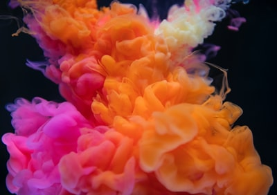 shallow focus photography of pink and orange smoke