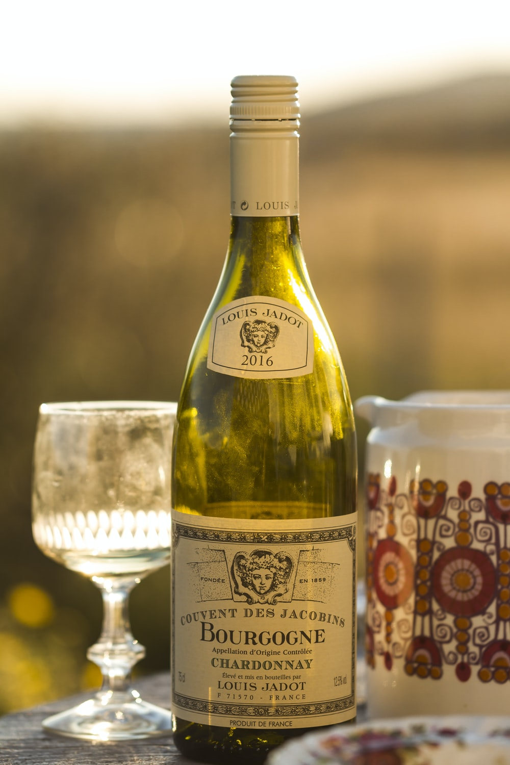 selective focus photography of Bourgogne bottle