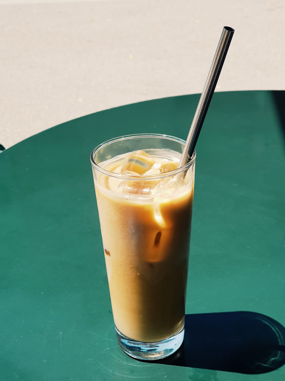 full coffee clear glass drinking cup
