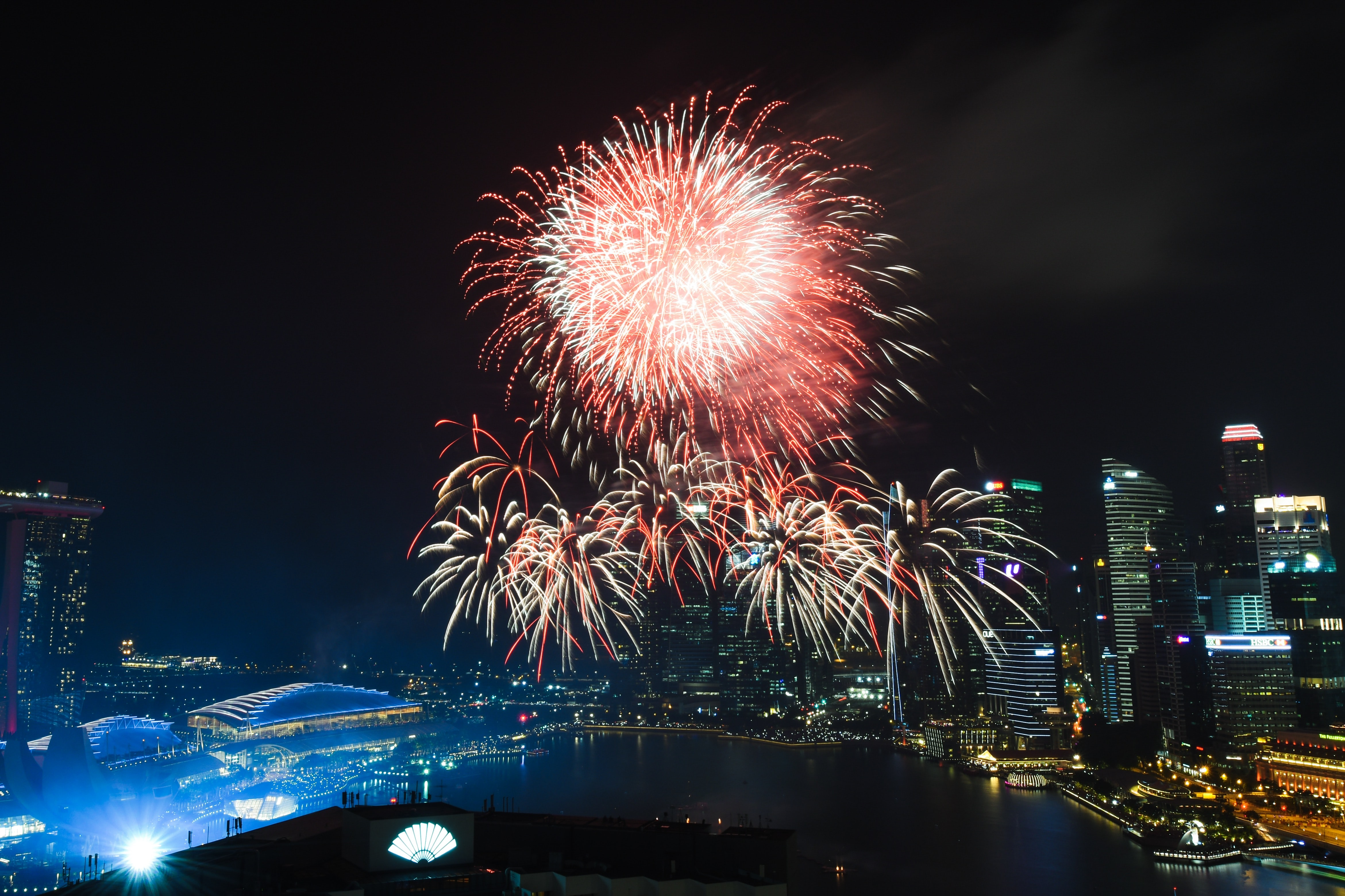fireworks exploding on sky of Marina Bay Sands at nighttime