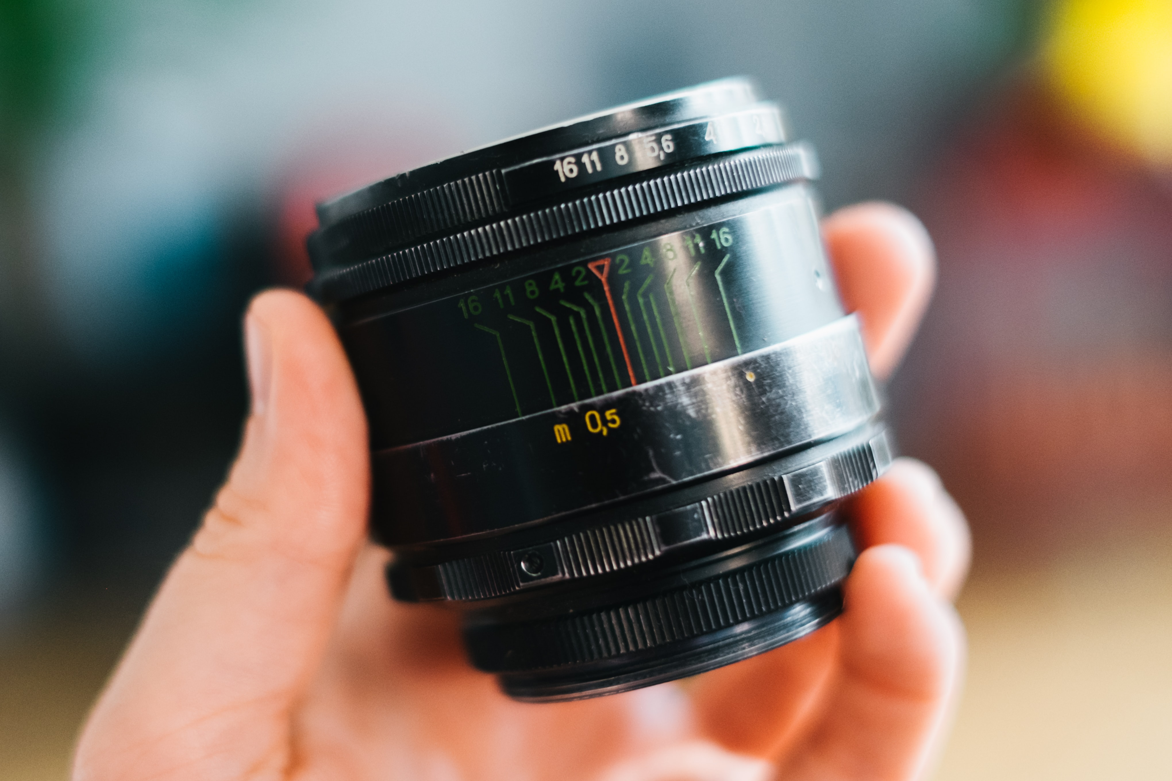 person holding black zoom lens