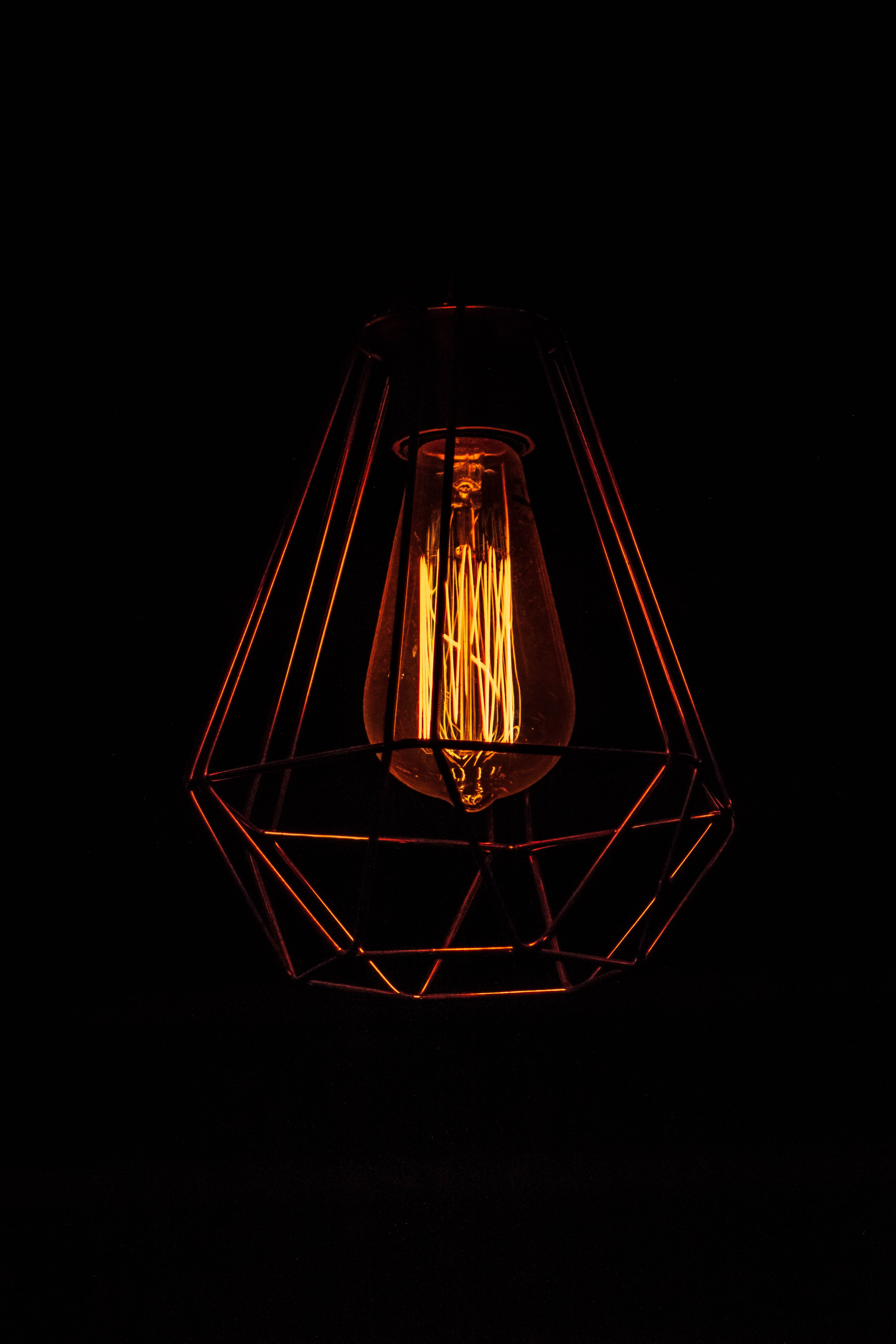 turned-on orange and gray lamp
