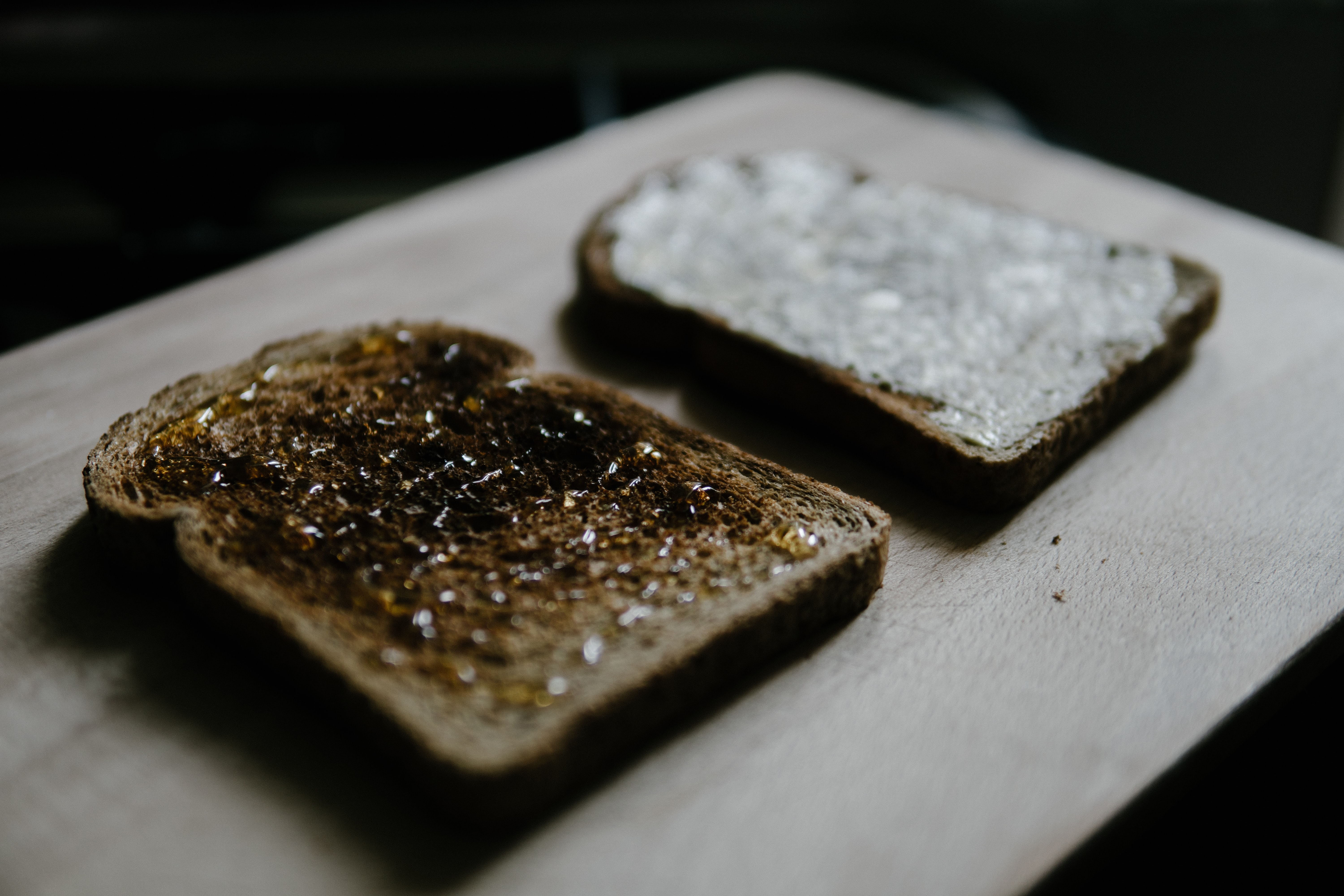 two toasted breads on wooden table