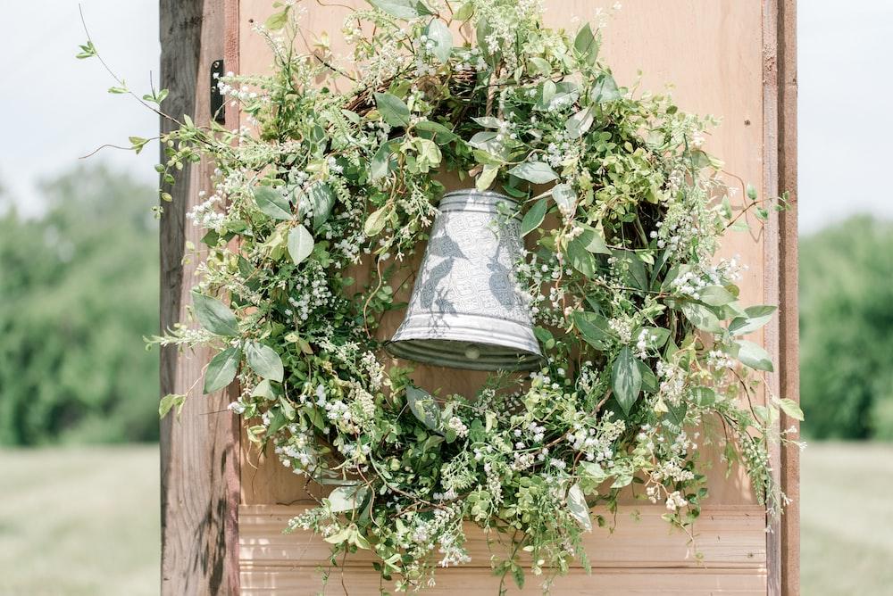 green wreath on brown board