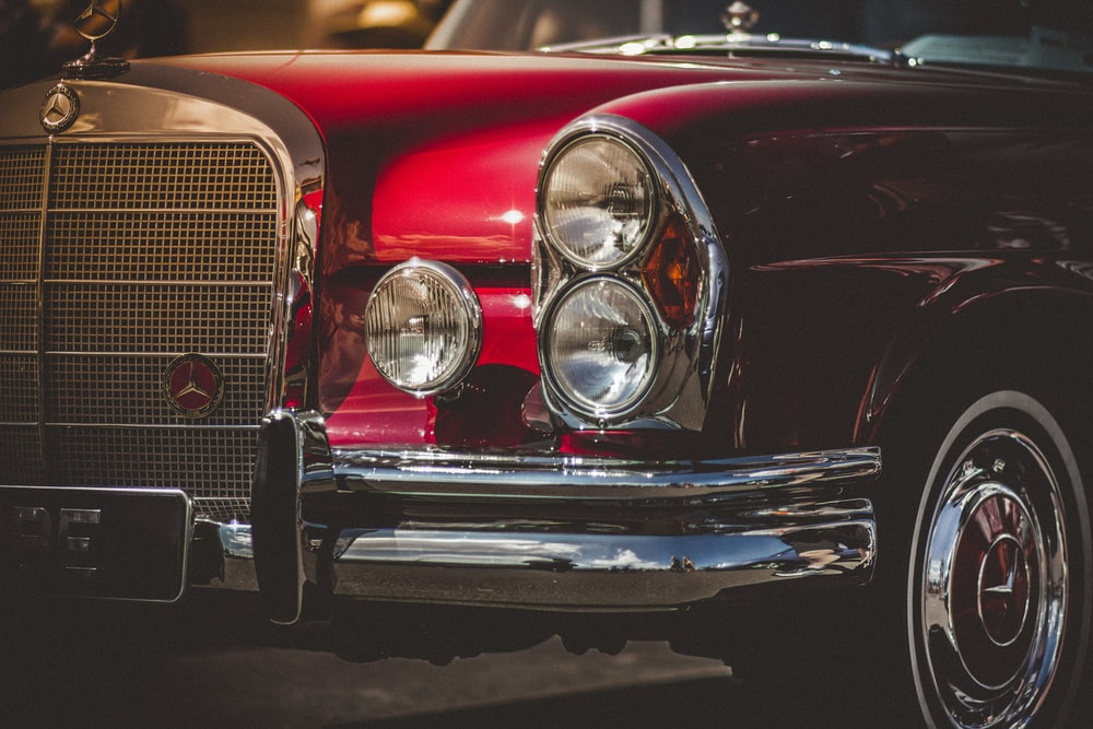 close-up photo of classic red vehicle