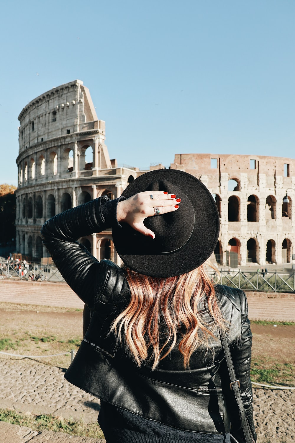 woman looking at Colosseum in Rome