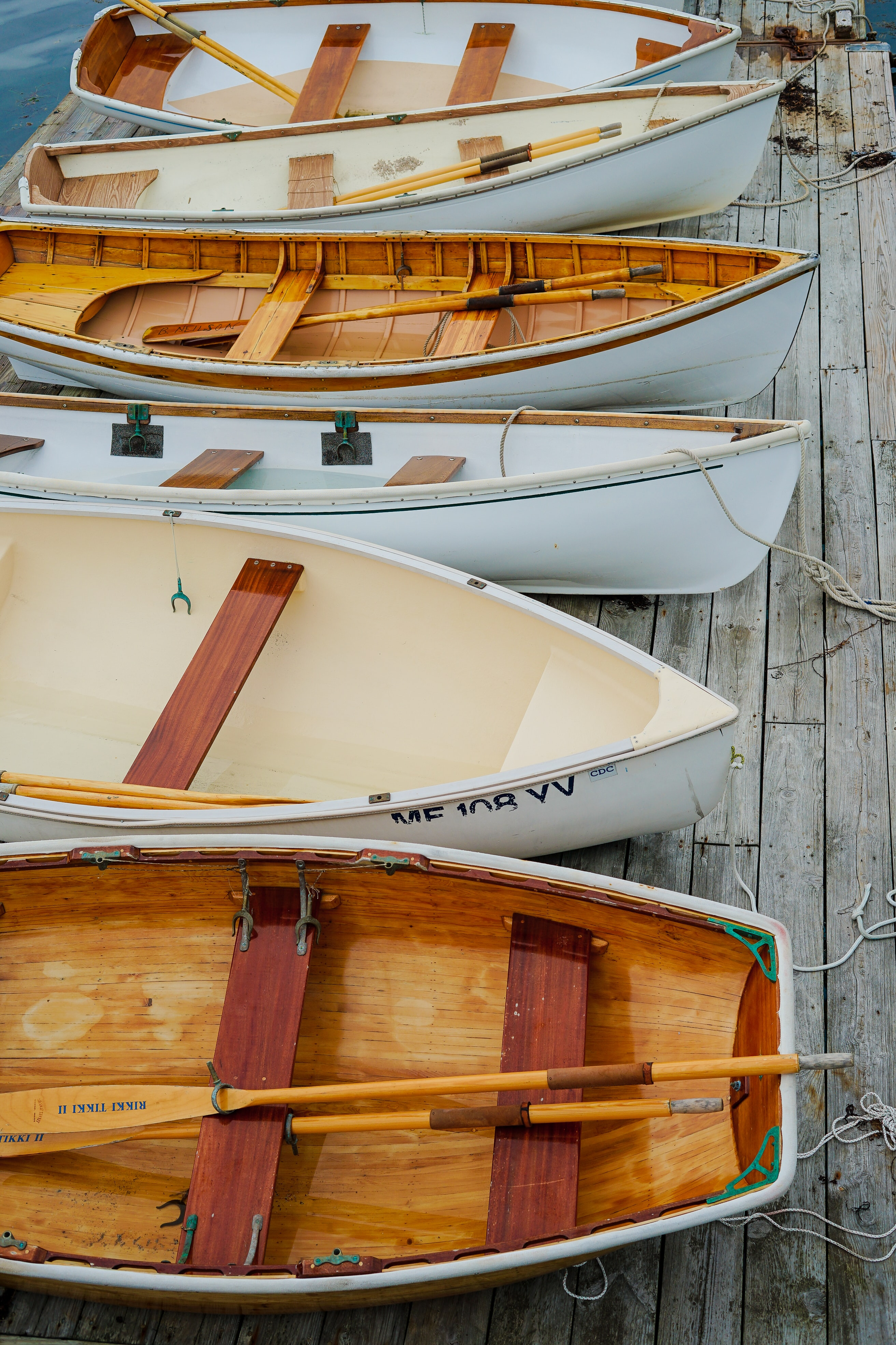 six brown-and-white woodn boats