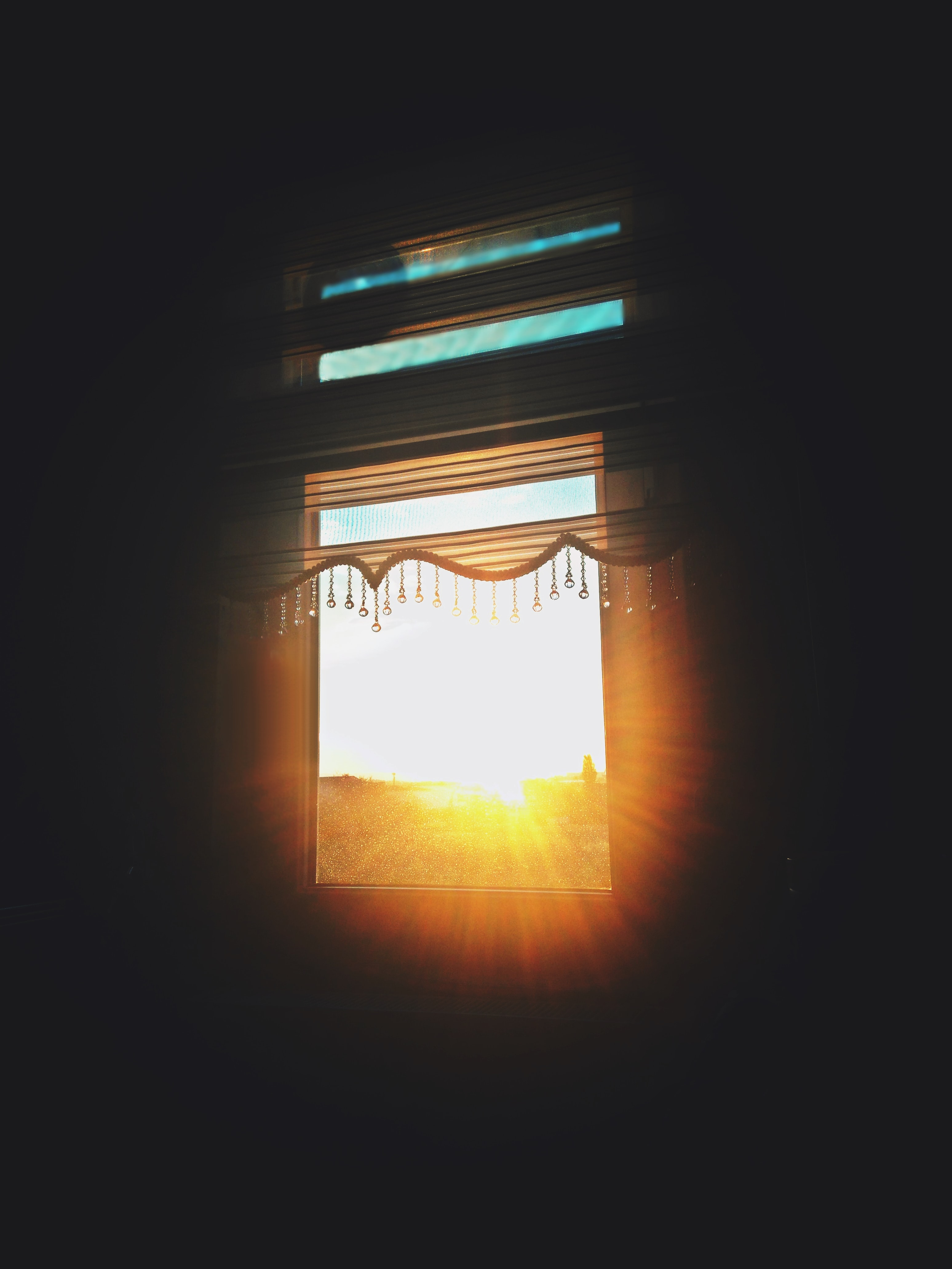 open blinds of window against sun rays