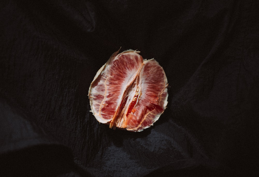 round red fruit on black textile