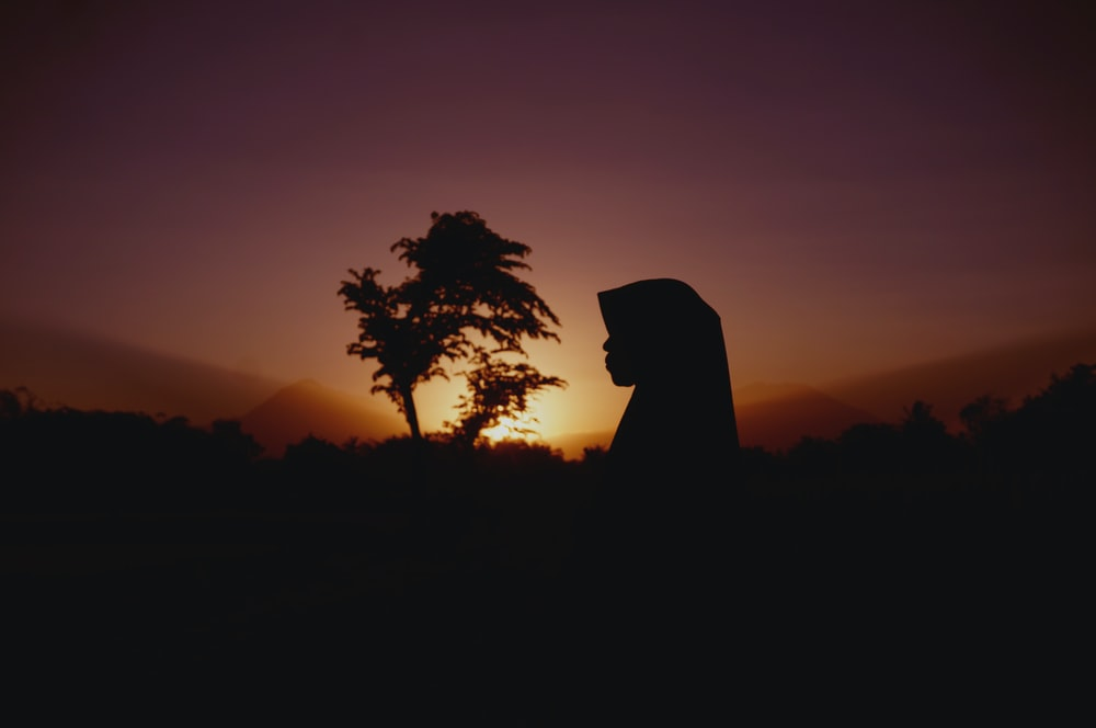 silhouette of woman and tree