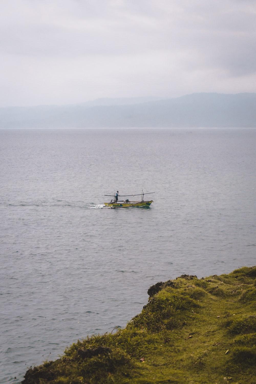 gray row boat on sea