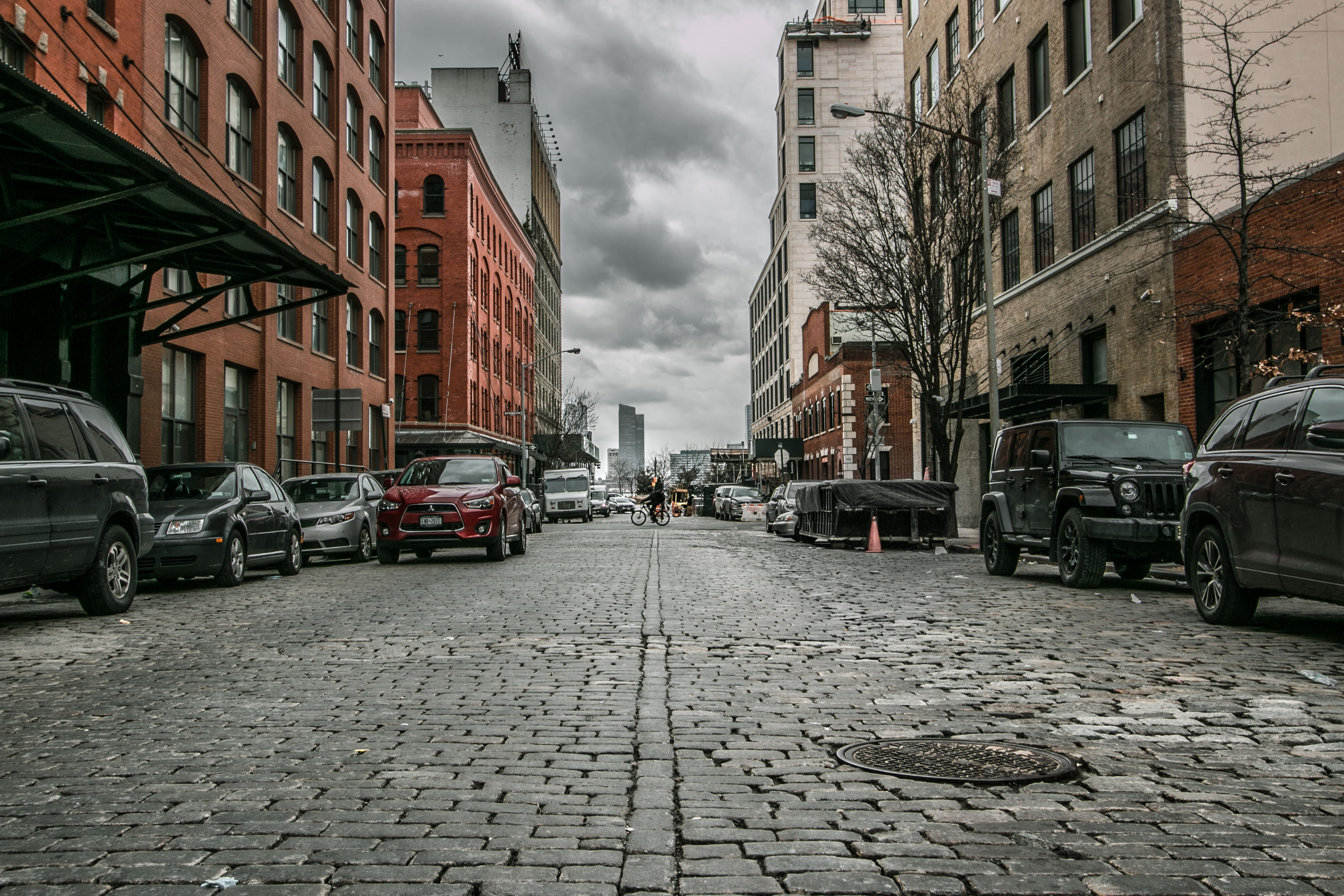 parked cars near buildings beside road