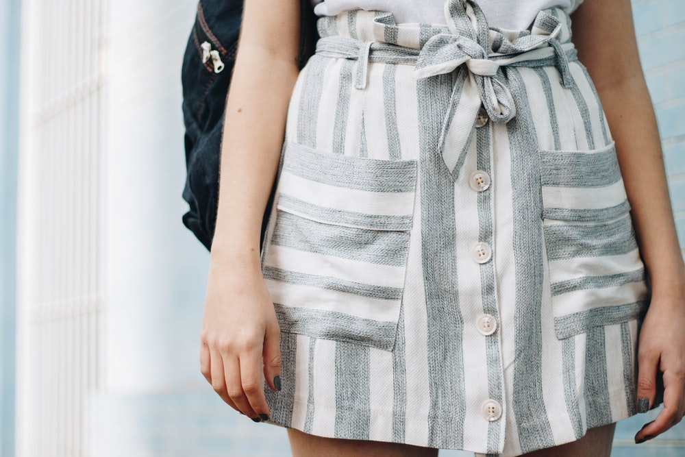 person wearing gray and white striped minidress