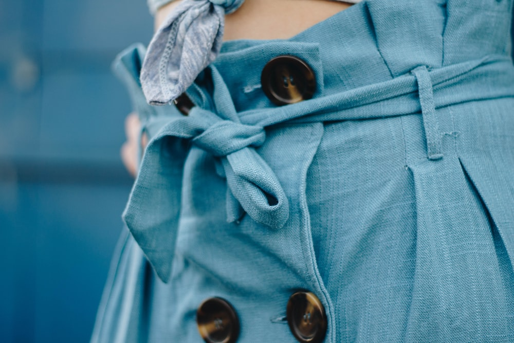 close-up photo of blue apparel during daytime