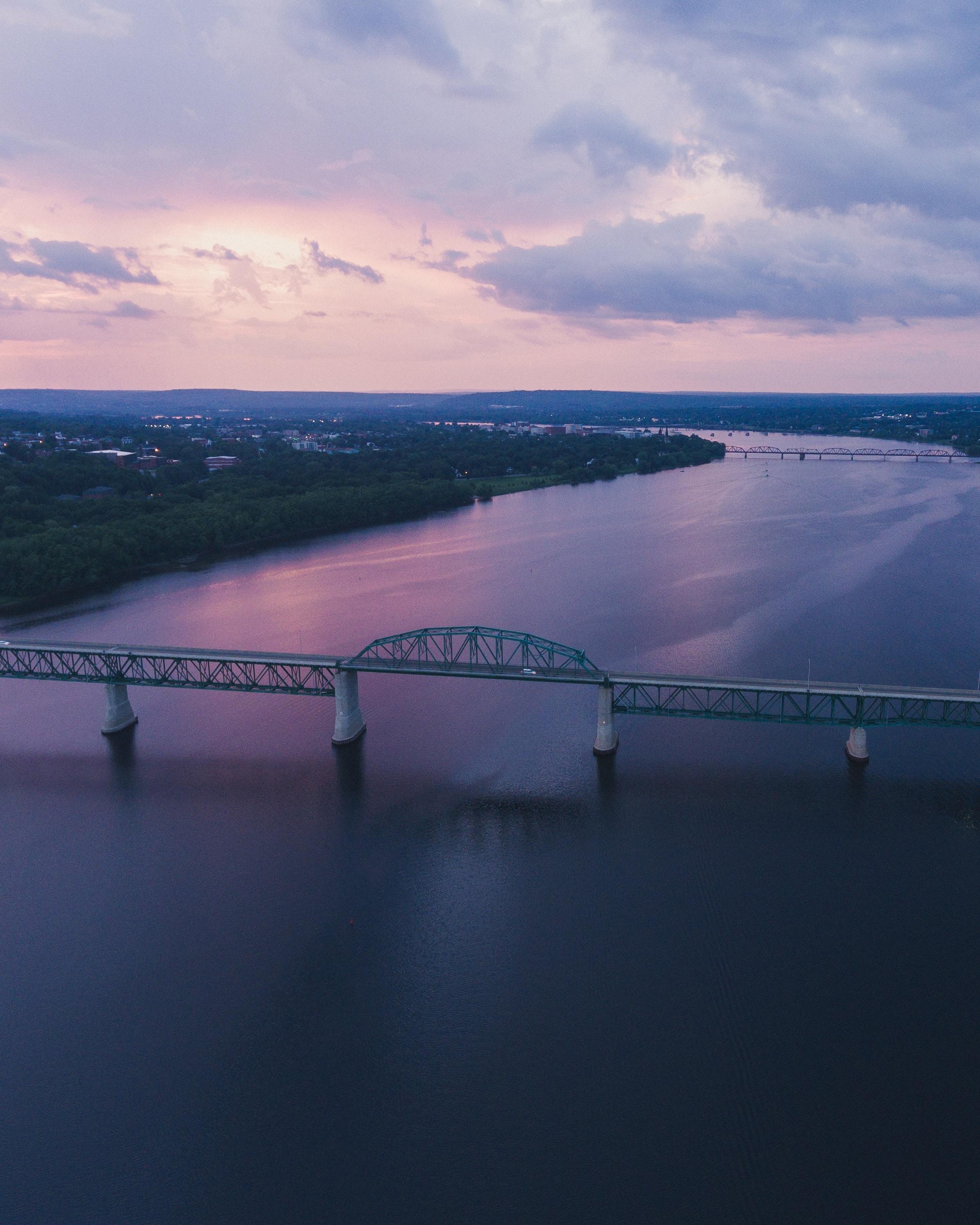 gray bridge during sunset