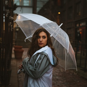 woman holding umbrella outdoor