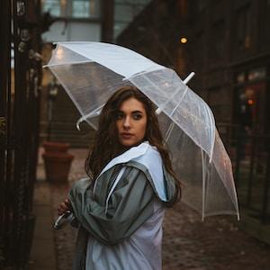 woman holding umbrella outdoor