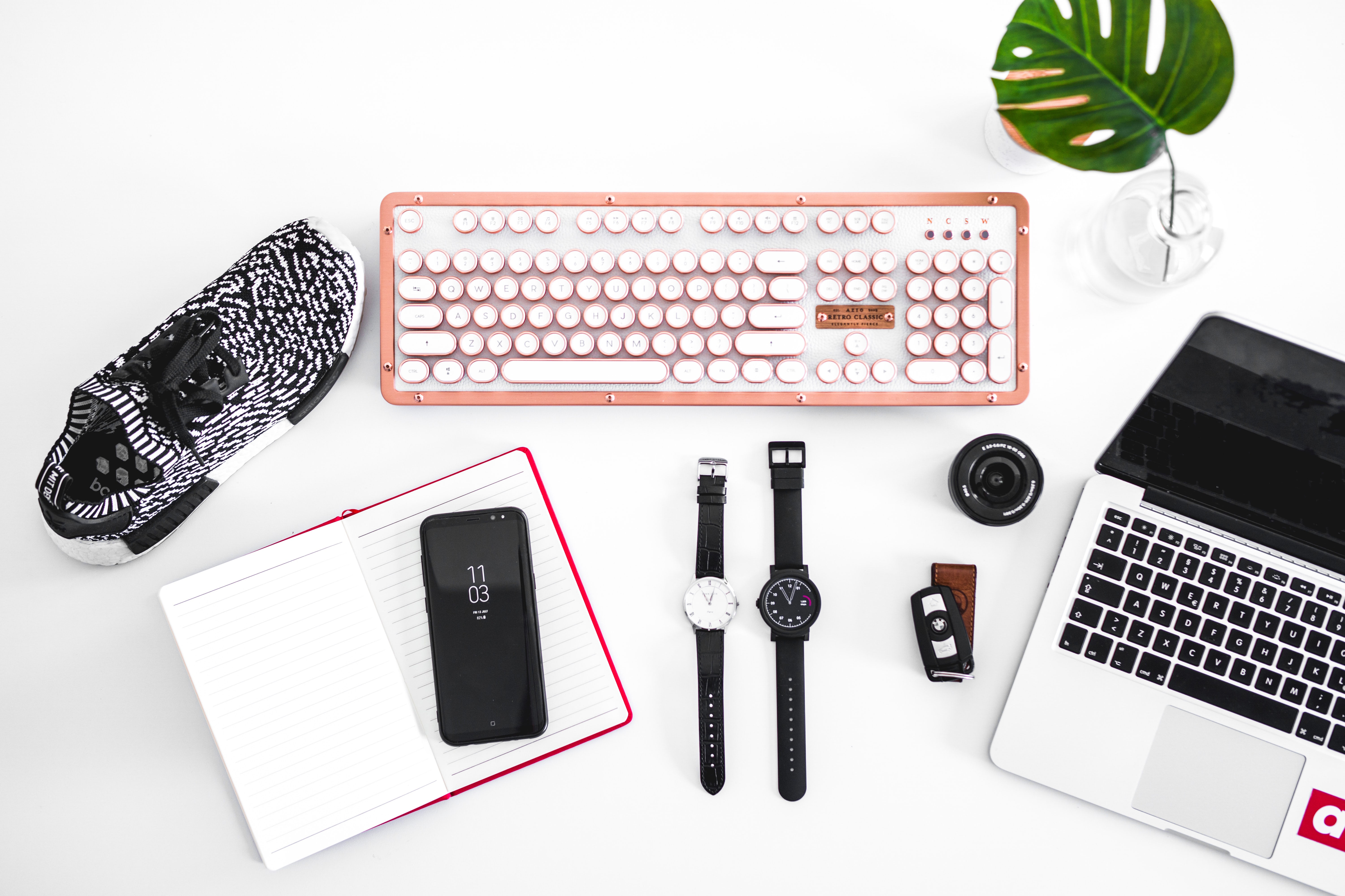 laptop computer beside analog watches on table