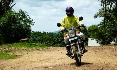 man riding motorcycle sierra leone teams background