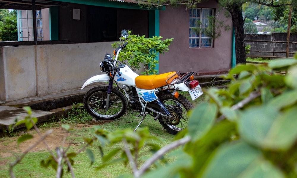 white and blue motocross dirt bike