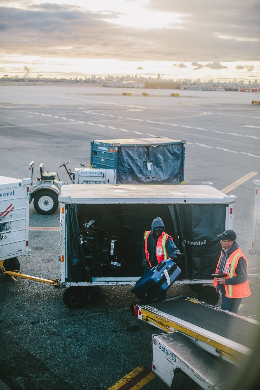 two men holding luggage on airport