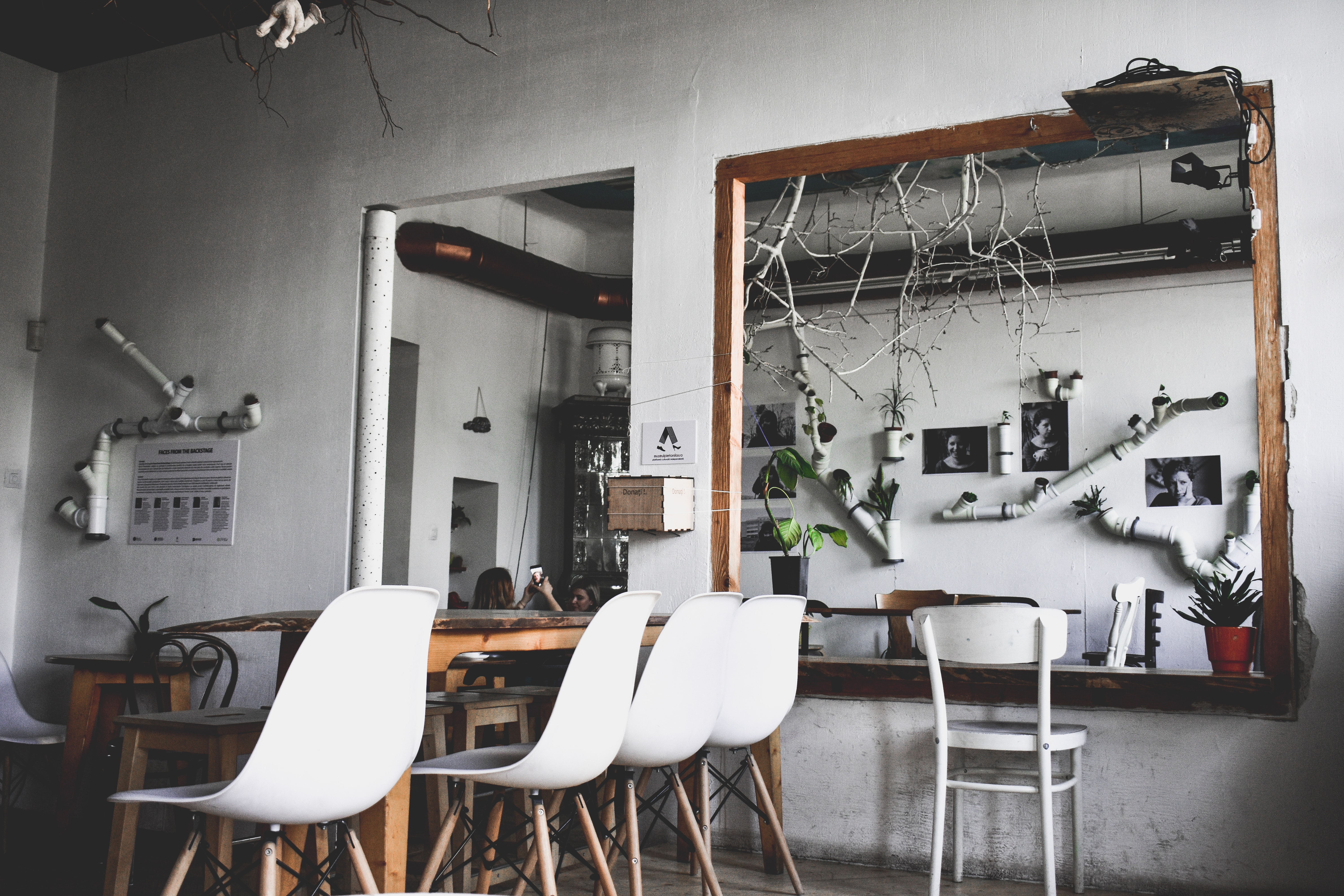 four white chairs near brown wooden table indoors