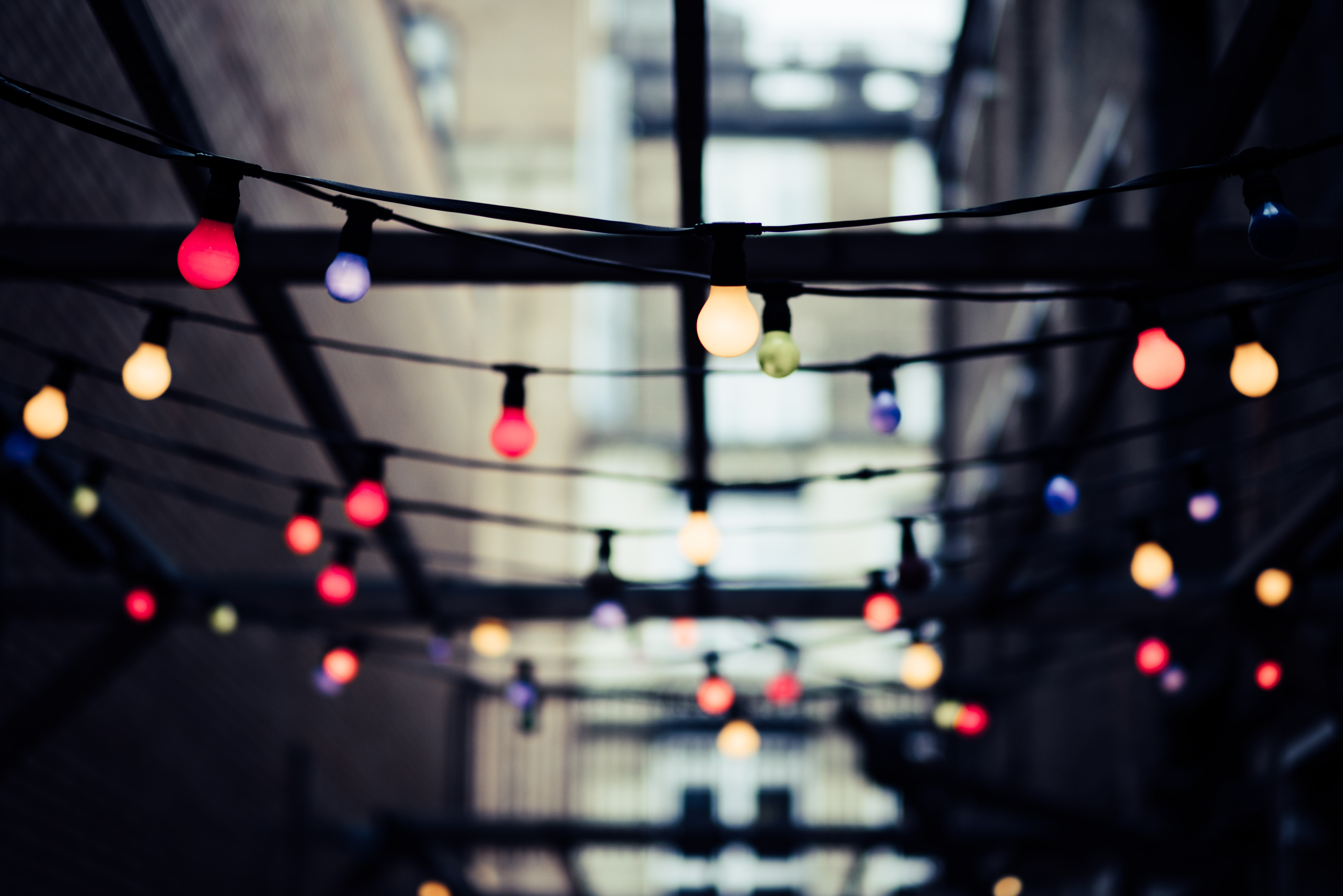 selective focus photo of string lights at daytime