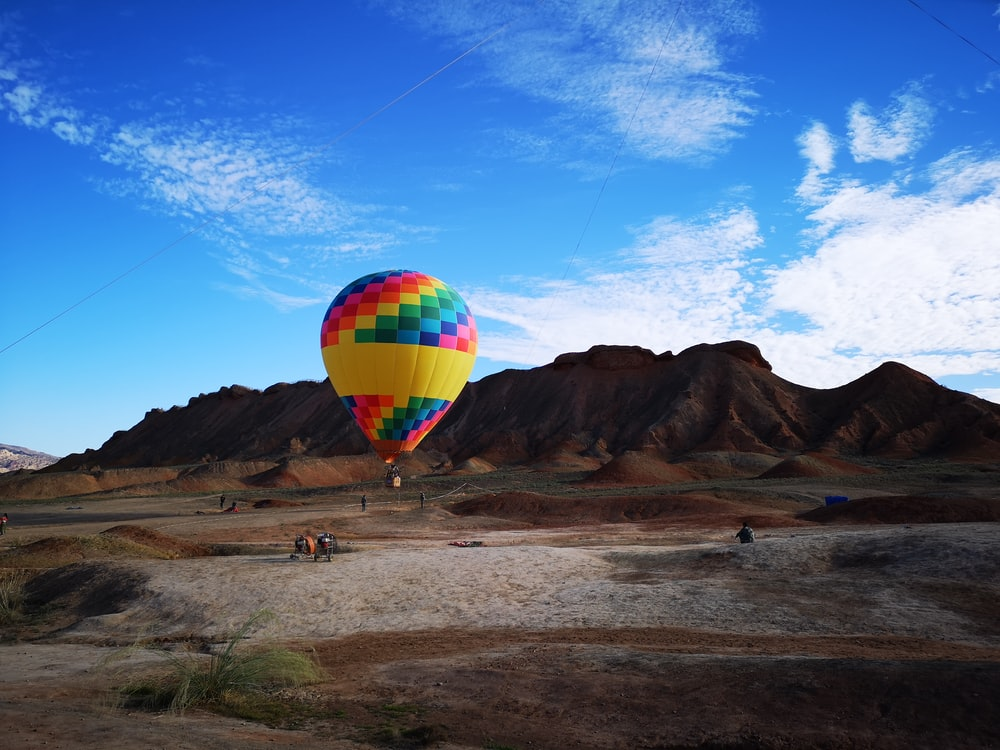 hot air balloon near mountains