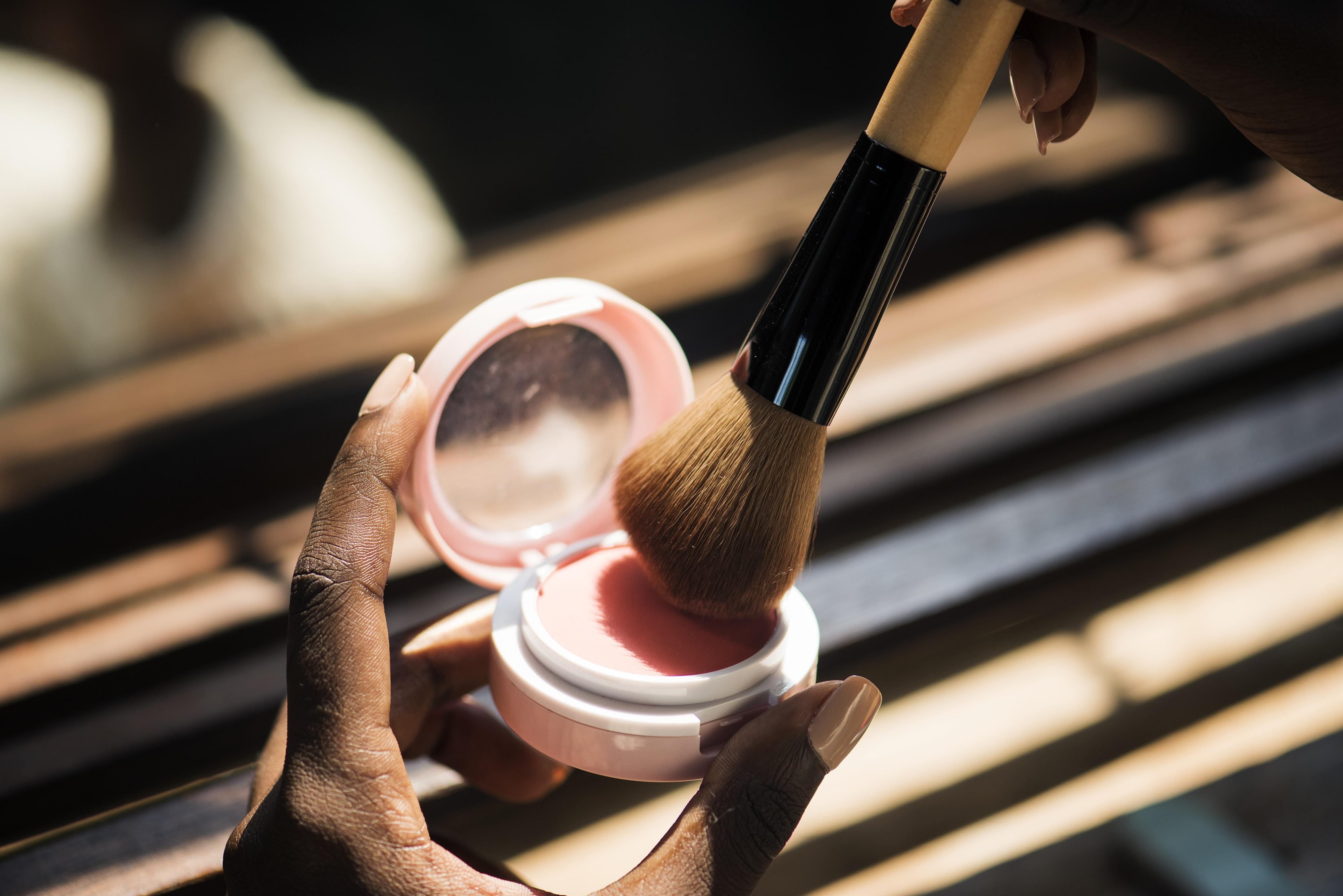 brown makeup brush on pink makeup foundation