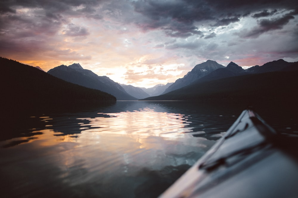 landscape photography of body of water and mountains