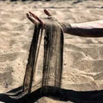 person holding grey sand photography