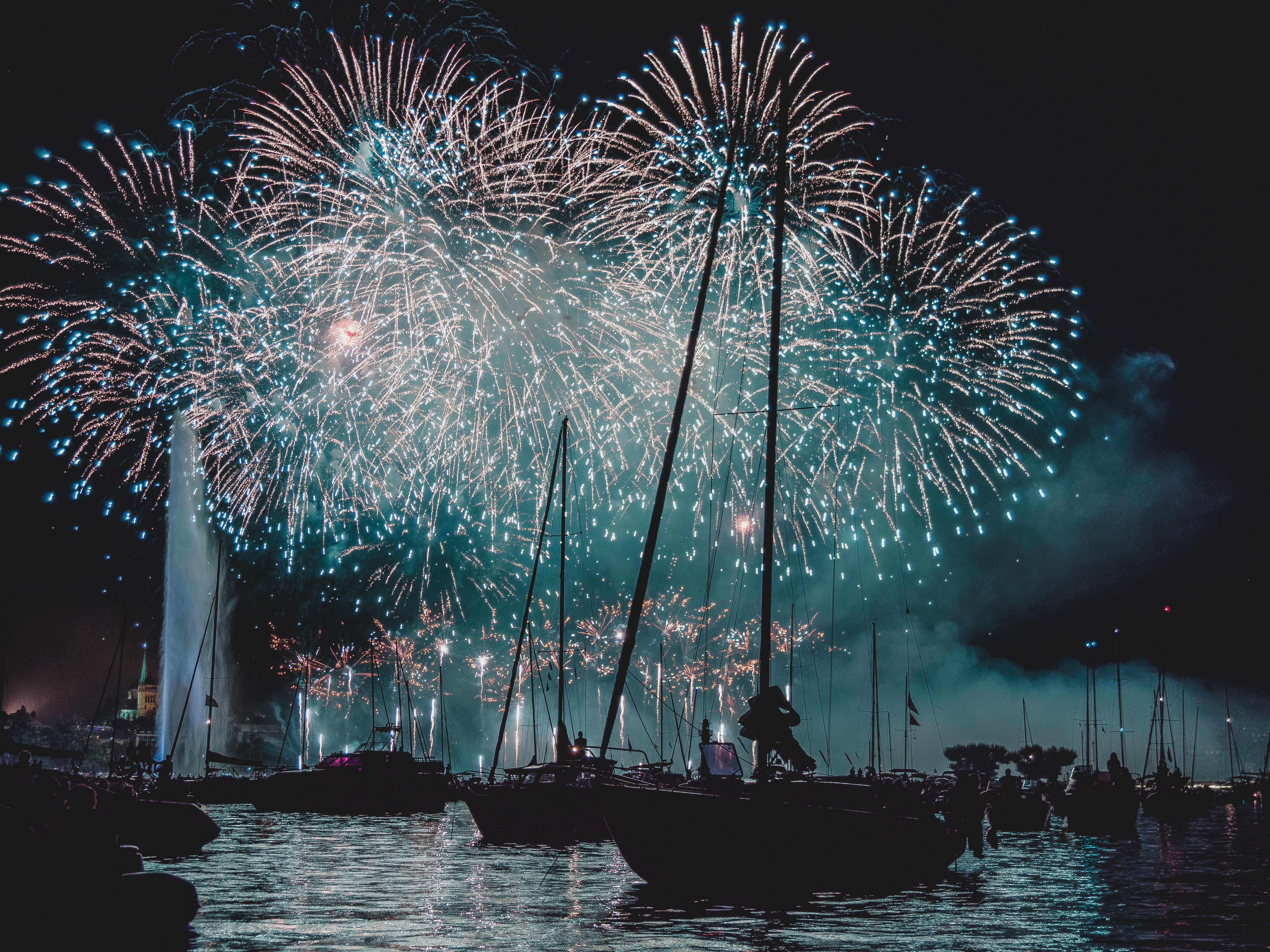 sail boats on water with firework displays