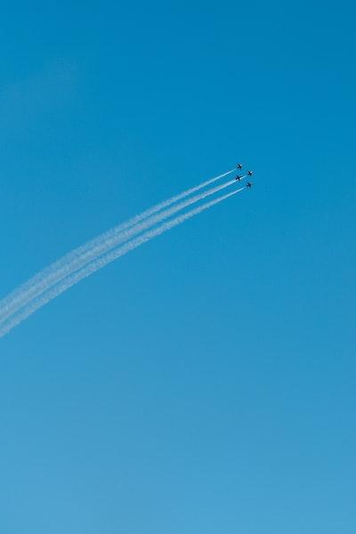 four jet planes in flight