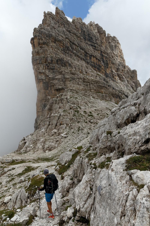 man standing on rocking mountain