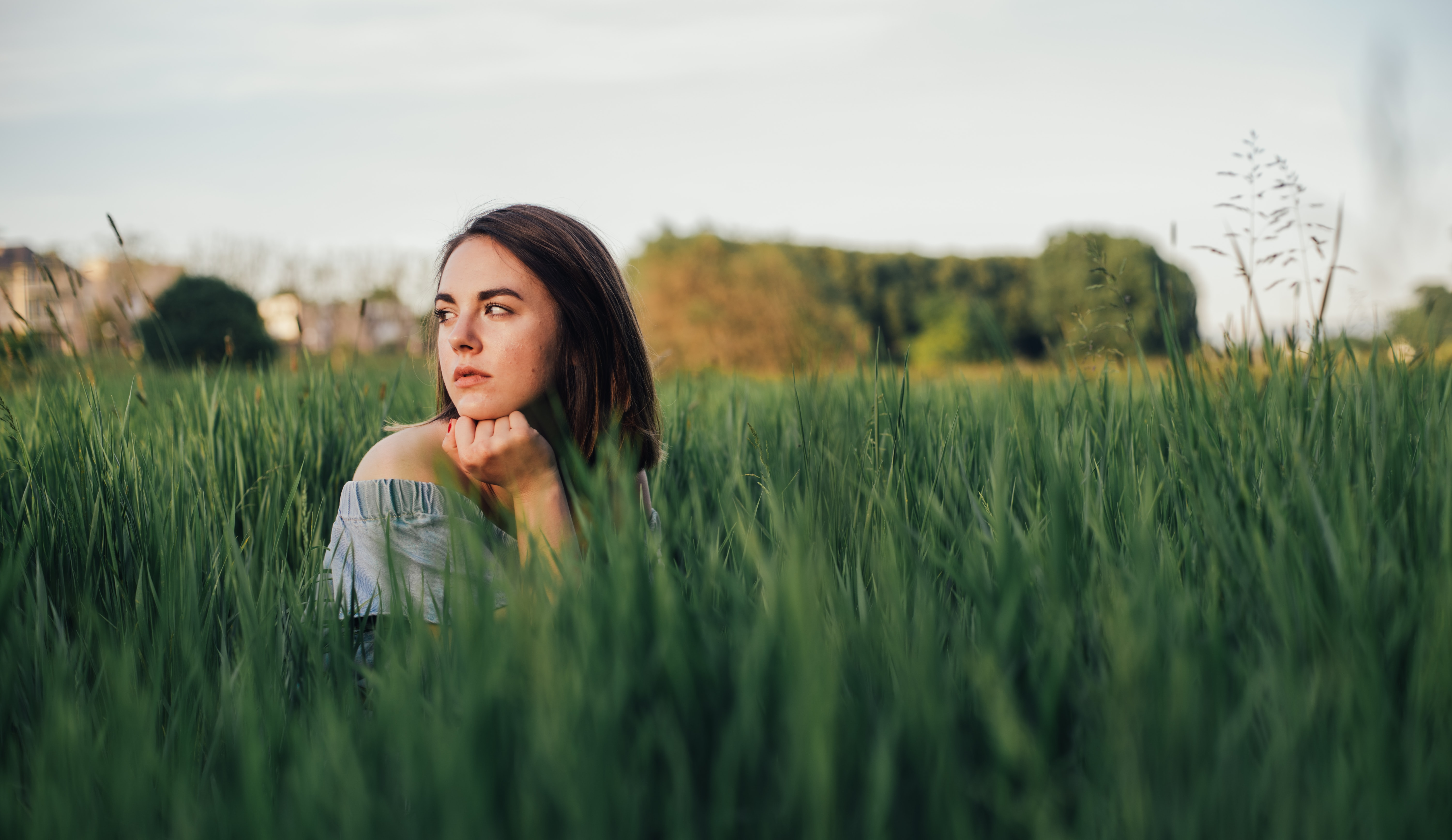 selective focus photo of woman near grass field