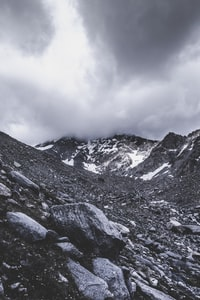 gray mountain under gray clouds during daytime