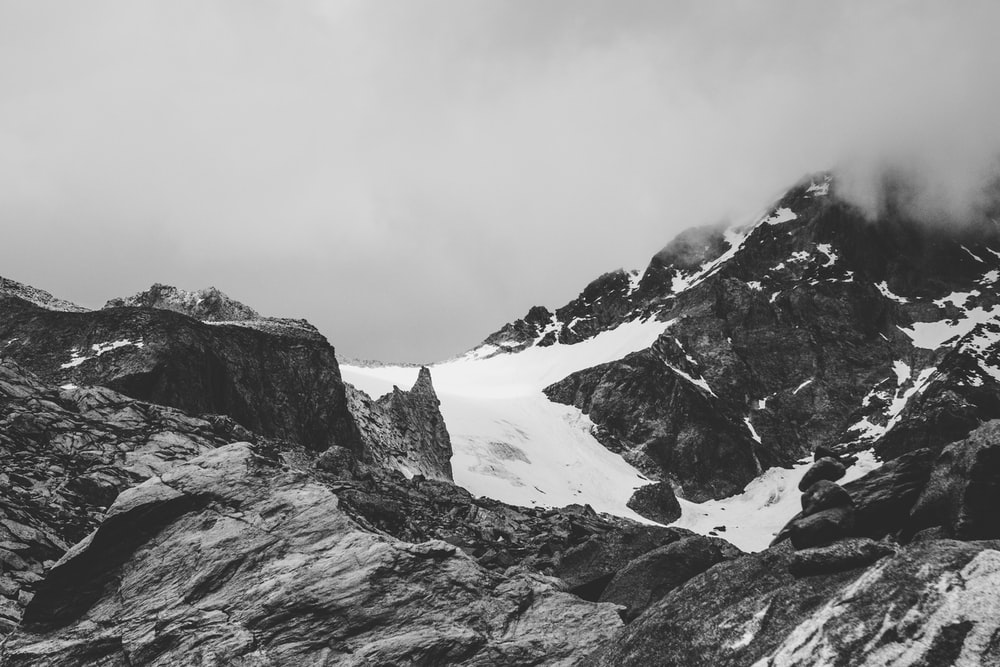 grayscale photography of snow cover mountain