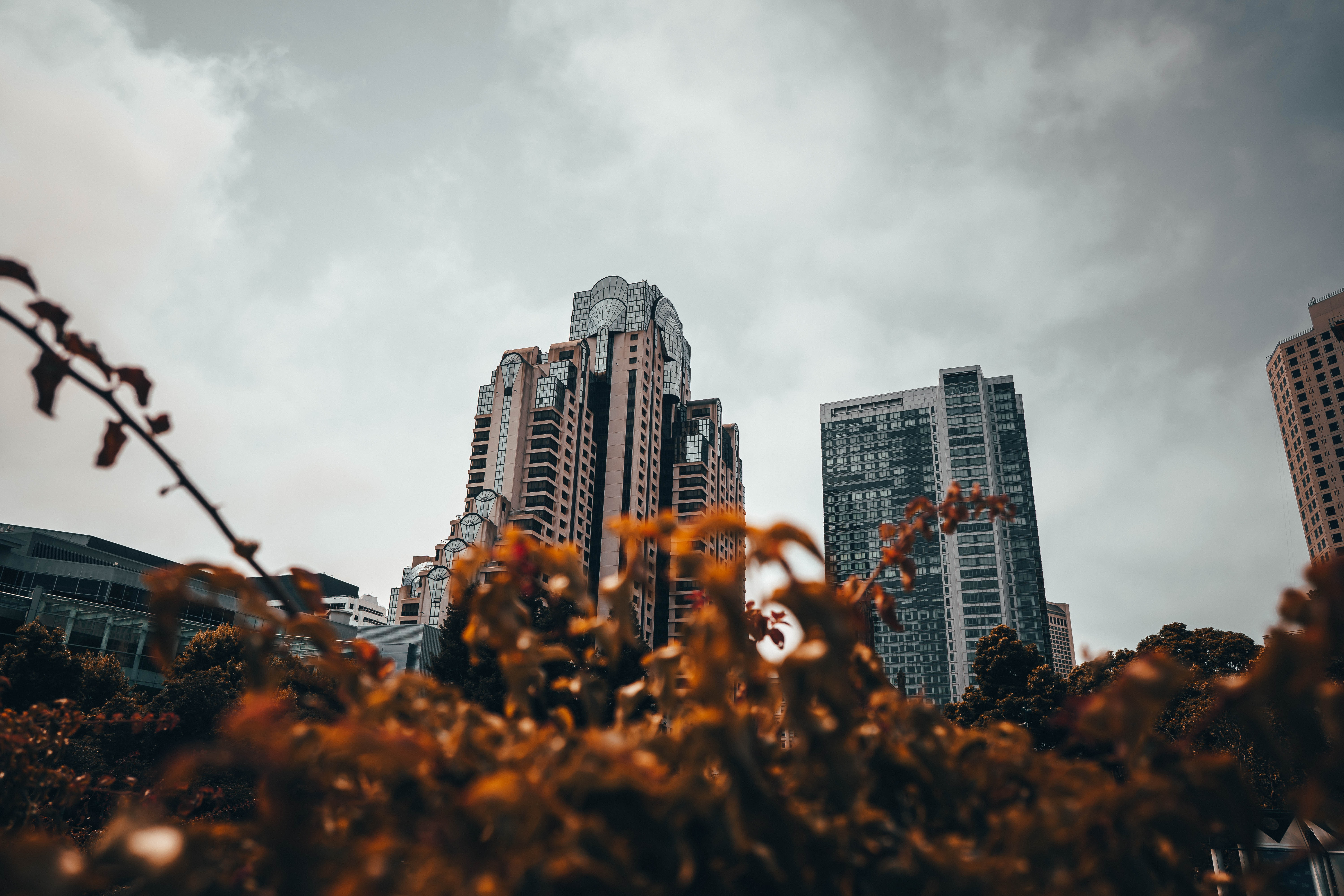 worm's-eye view of building under cloudy sky