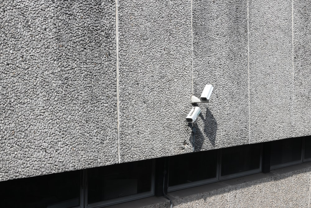 bullet security camera on concrete wall