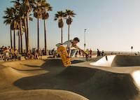 time-lapse photo of man riding skateboard at skate park