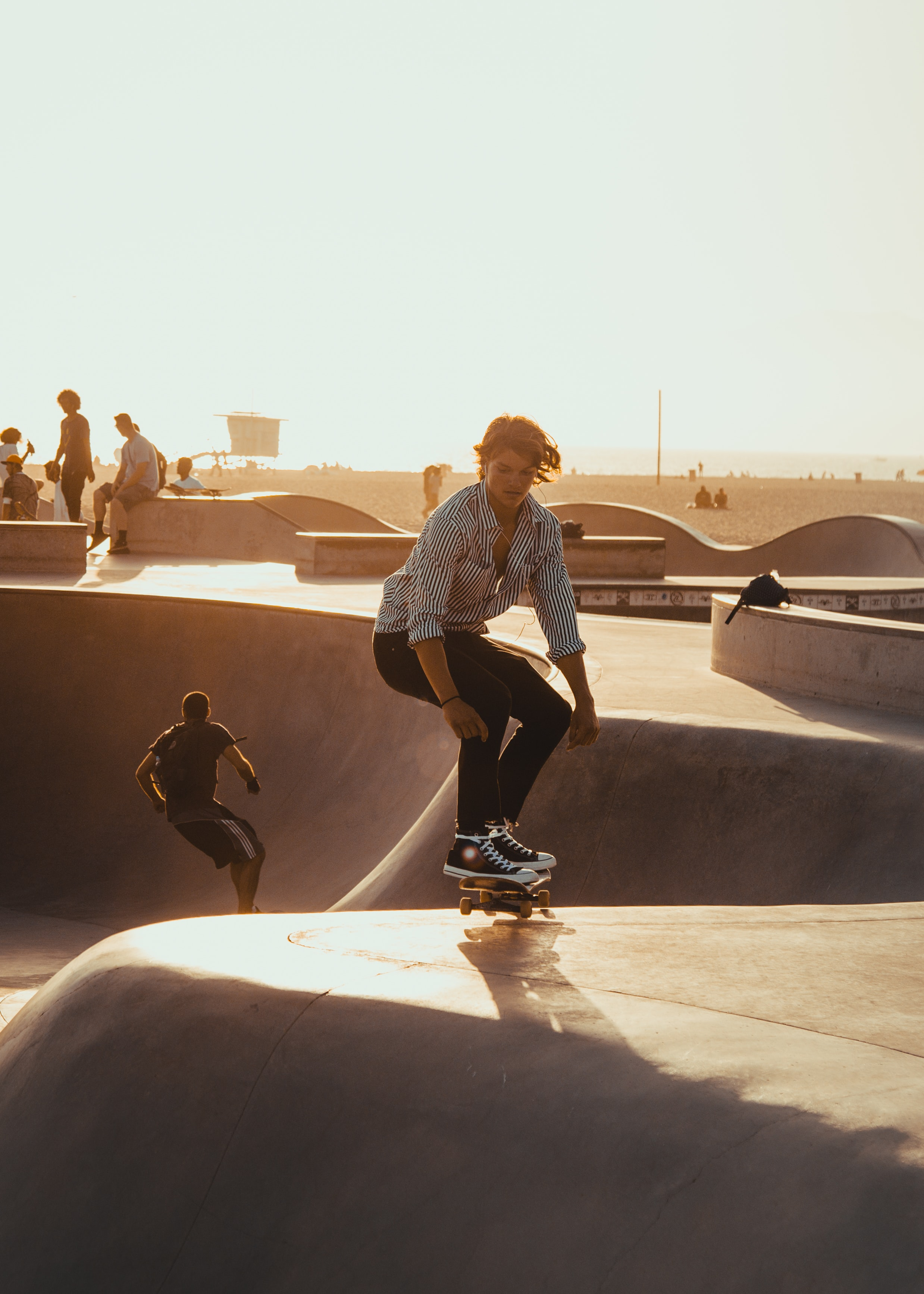 man riding skateboard on skate park during daytime