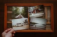 person holding four photos