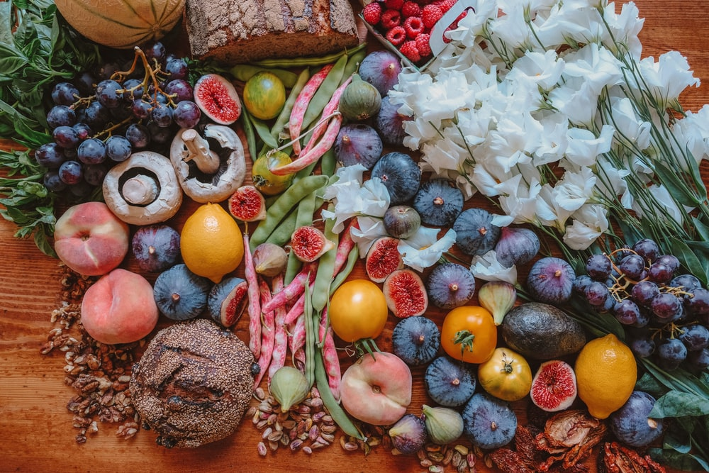 assorted fruit and seasoning on table