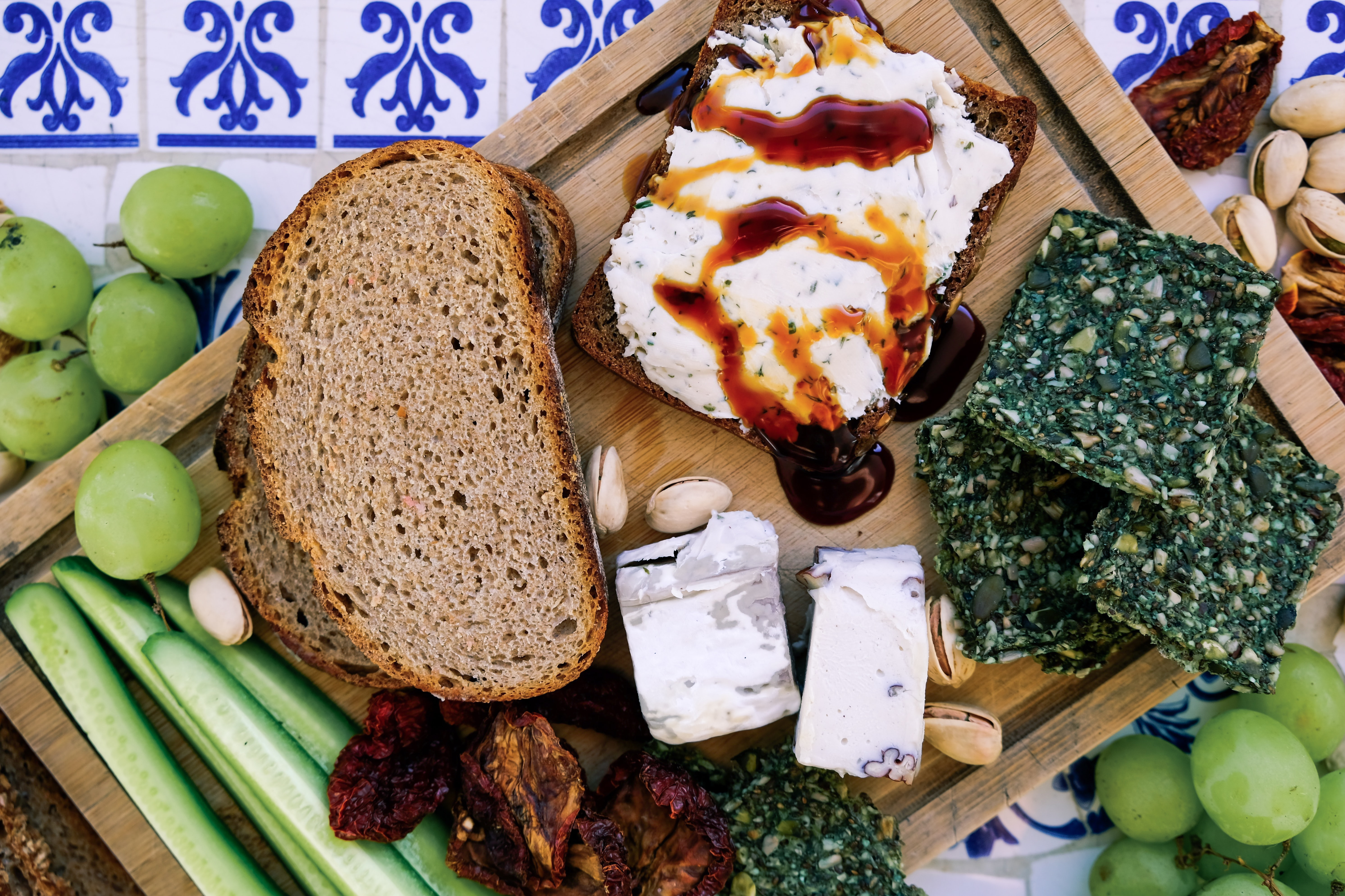 bread and vegetables on brown wooden board