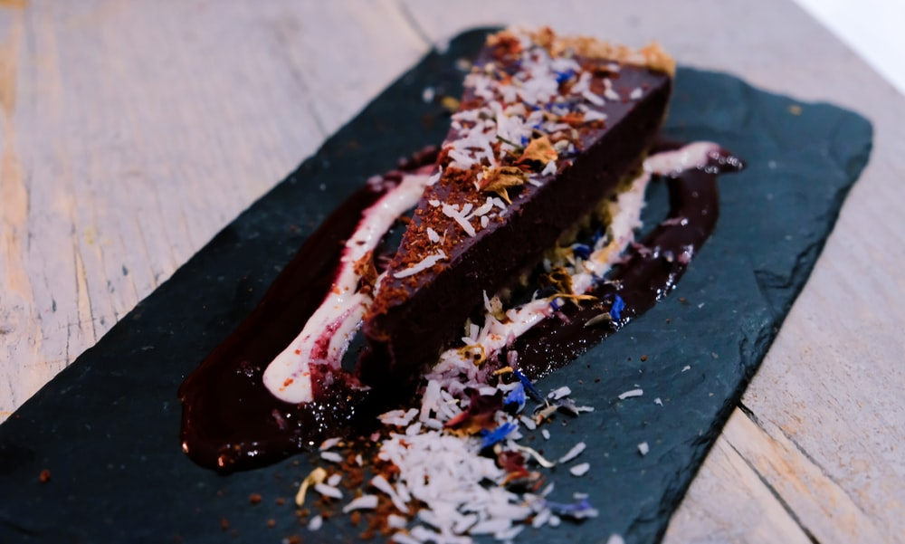 sliced chocolate cake with flakes