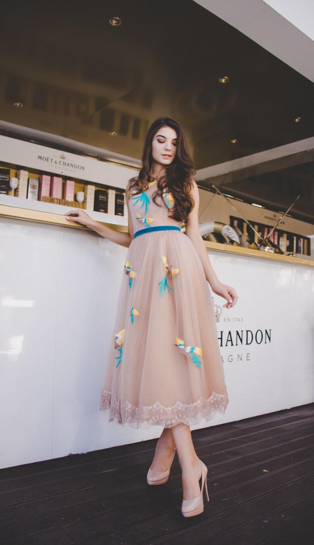 woman wearing peach-colored maxi dress