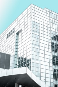 white and clear glass high-rise building