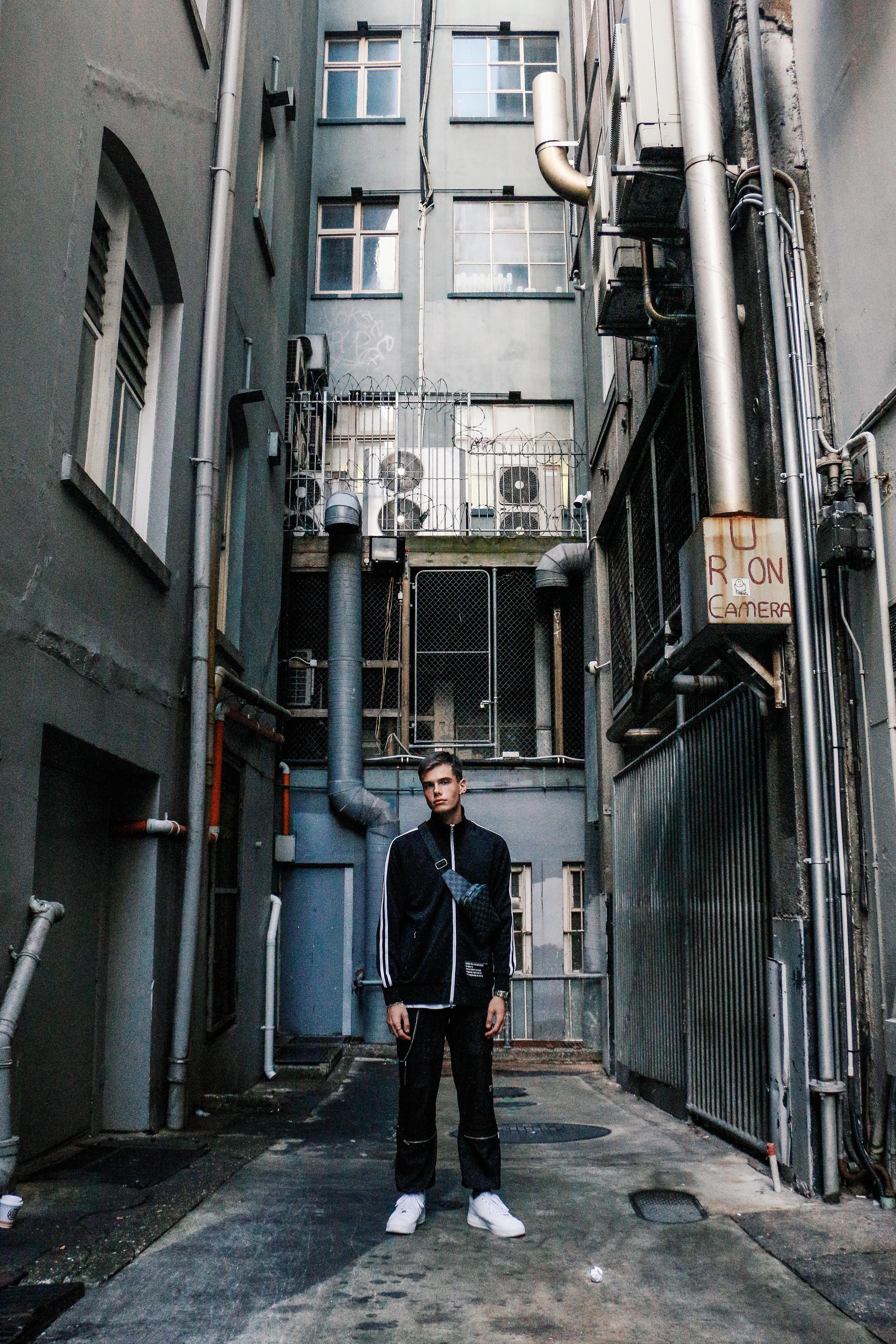 man in between building