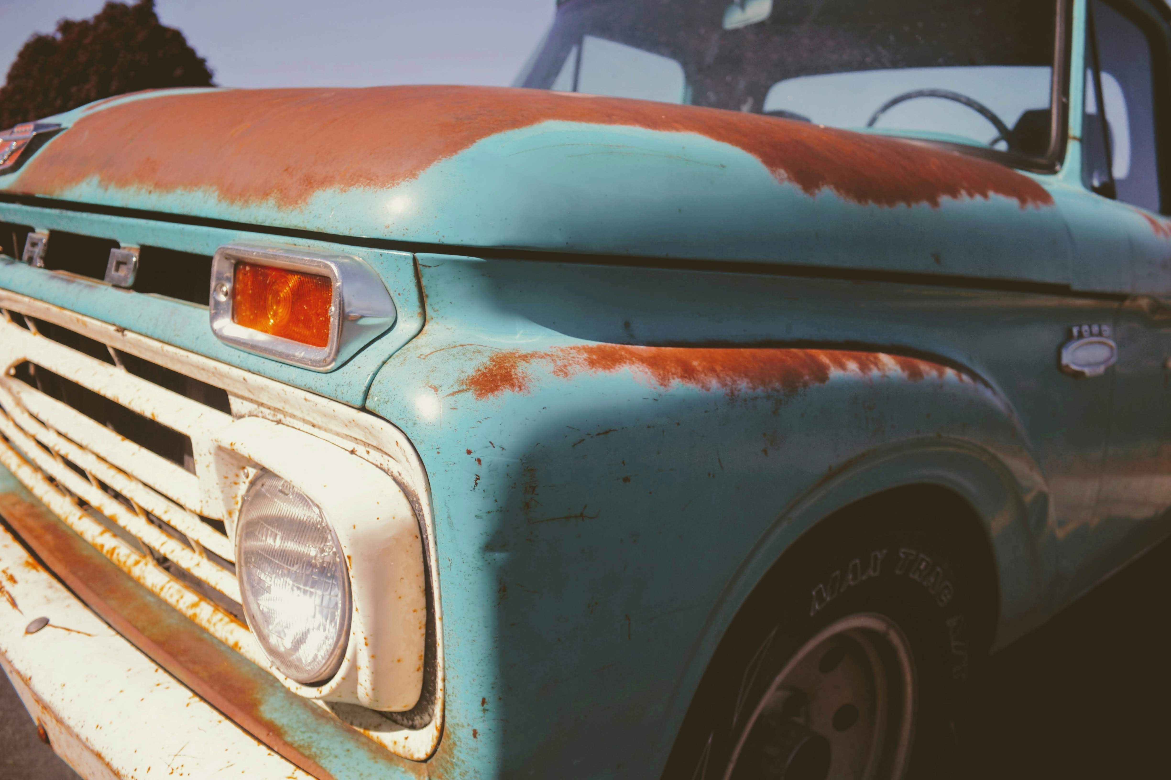 classic blue and brown vehicle